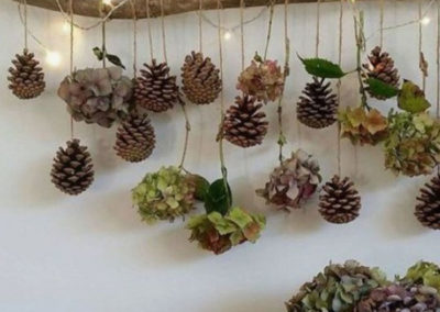 Wall decoration with hanging pine cones