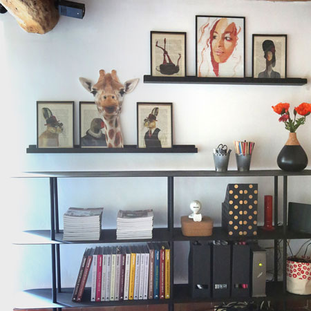 Creation of made-to-measure furniture, a black metal shelving unit
