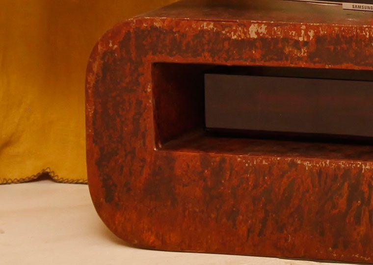 detail of a custom made tv cabinet in rusted metal