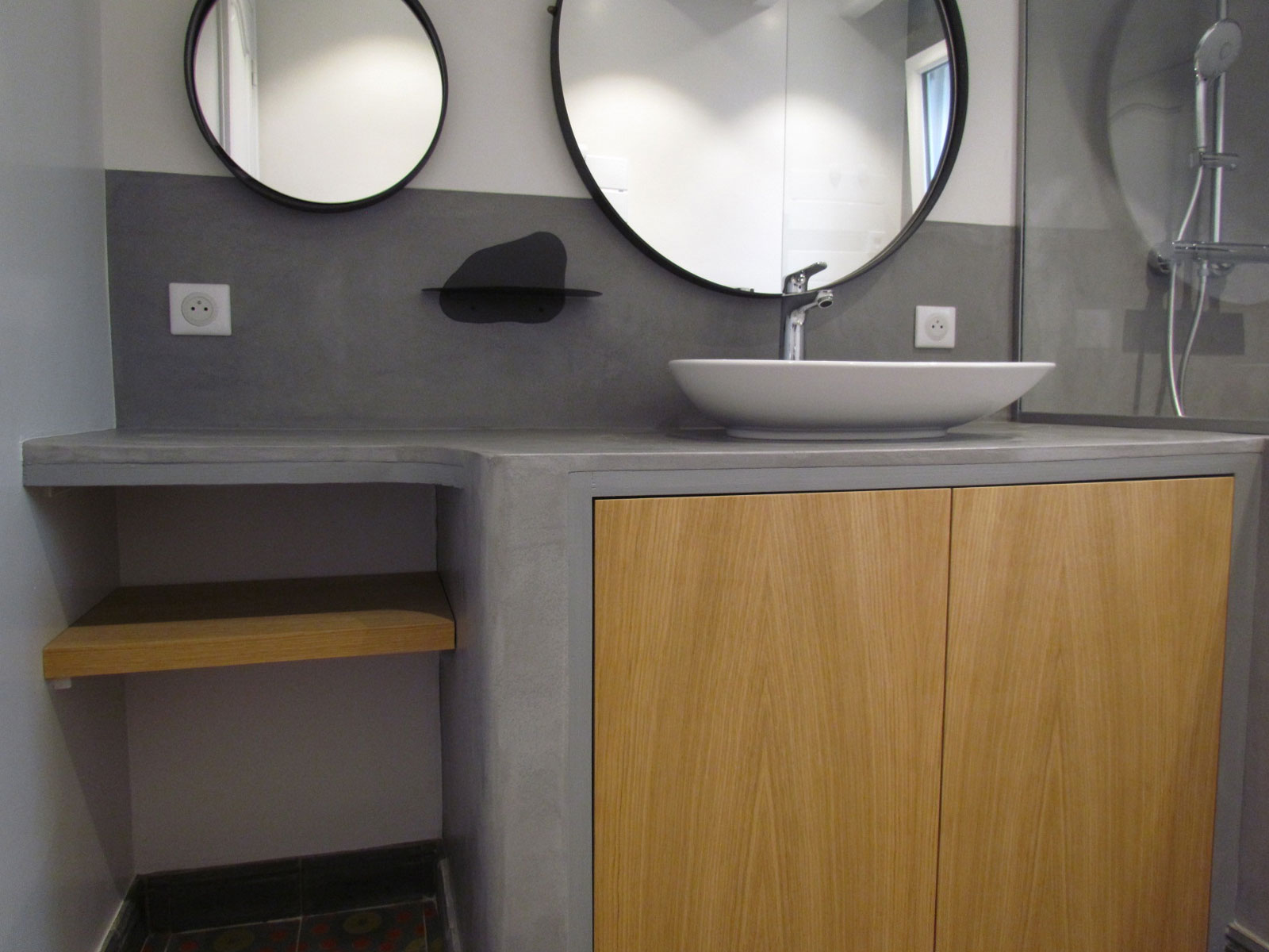 bathroom with a waxed concrete washbasin top with an organic shape